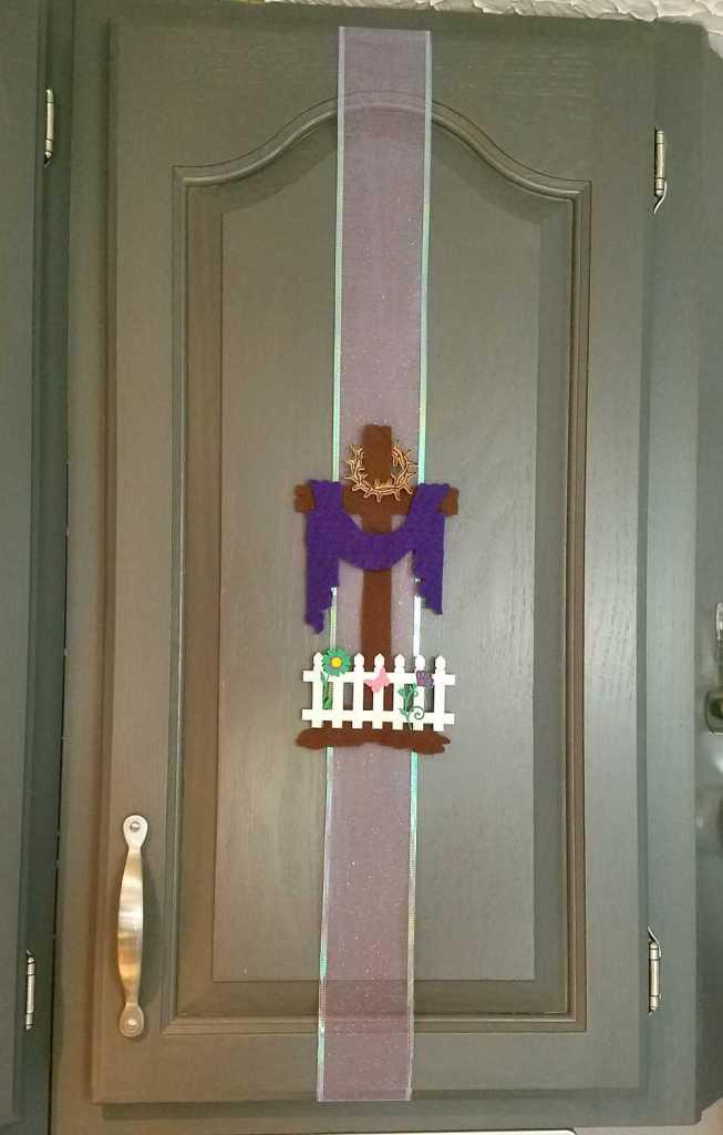 Easter cross on cupboard door