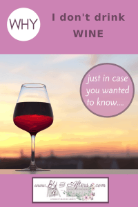 wine in a glass with sunset in background