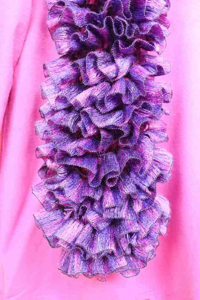 pink and purple knitted scarf closeup