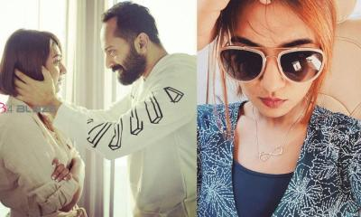 Nazriya wearing a locket with the name of Fahadh and another one