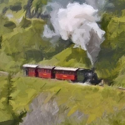 steam engine winding through a valley