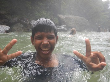 Chris swimming at the waterfall
