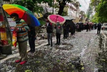 Nanital People amidst  rain and hail storm standing