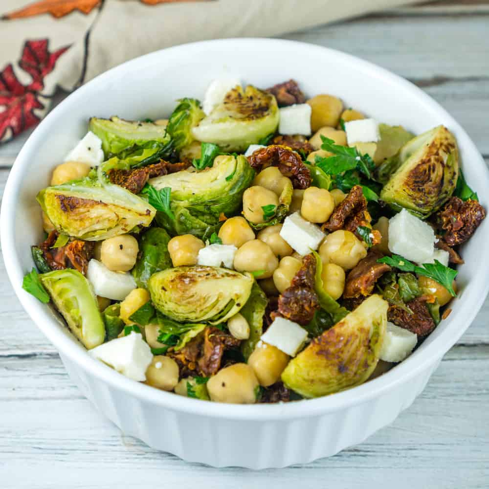 Roasted Brussels Sprouts and Chickpeas Salad with Sun-Dried Tomatoes and Queso Fresco in a lemony dressing. From www.babaganosh.org
