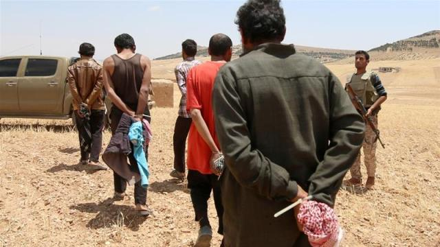 The Syrian Democratic Forces handed thousands of ISIL prisoners over to Iraq [File: Rodi Said/Reuters]