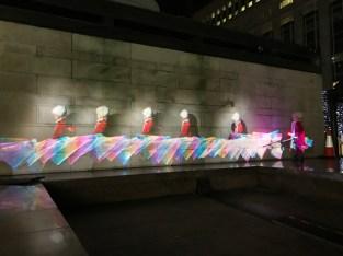 Nadia painting withLuma Paint Public Light Graffiti as Lightpainting, London Winter Lights, Canary Wharf, 2017