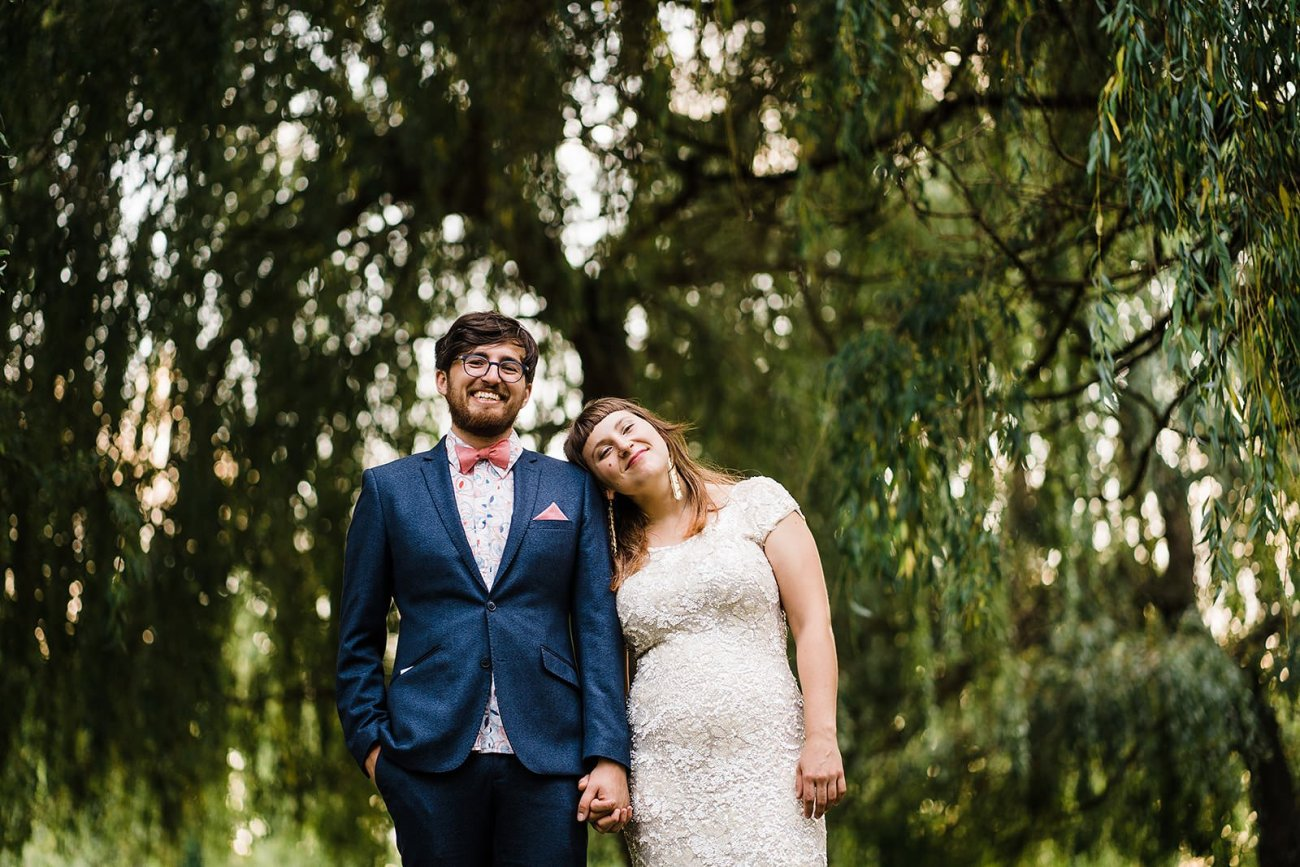 bride and groom portrait in front of willow tree