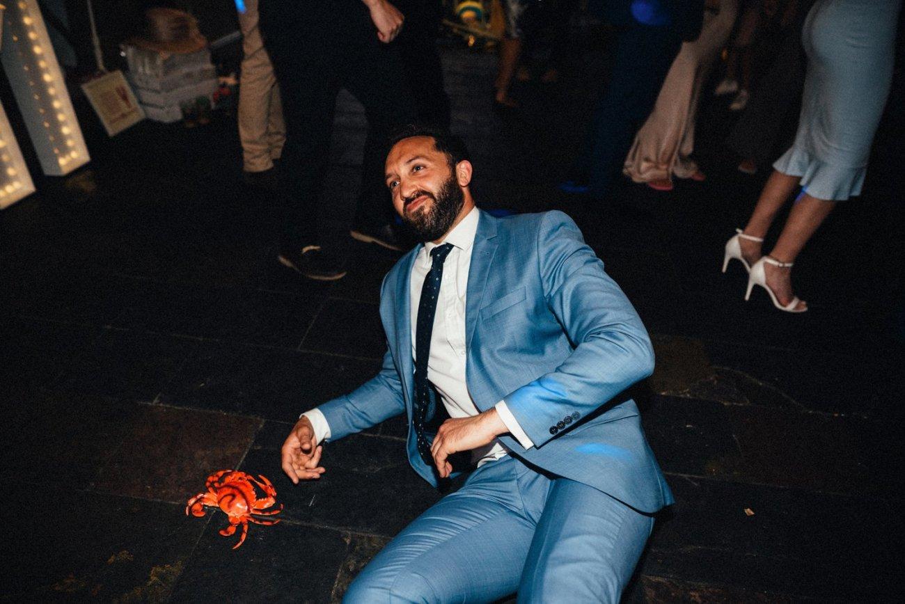 Man dancing with crab Kent wedding