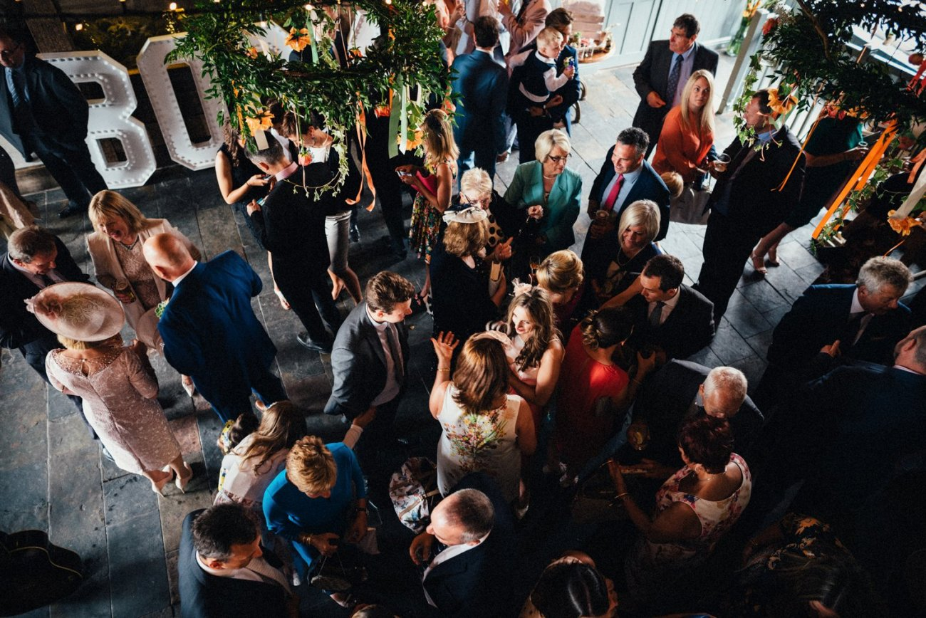 Whitstable wedding guests mingle