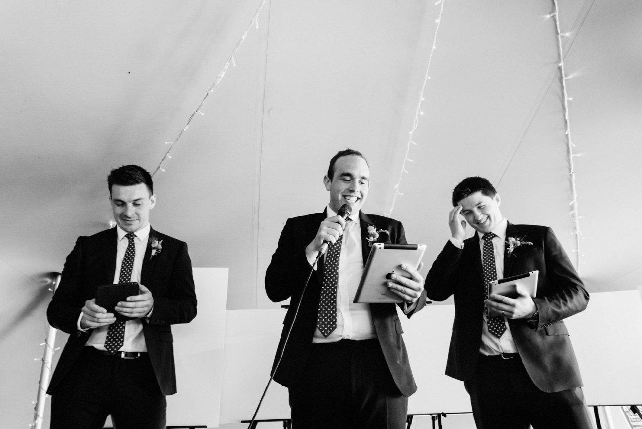 Best men giggling during speeches
