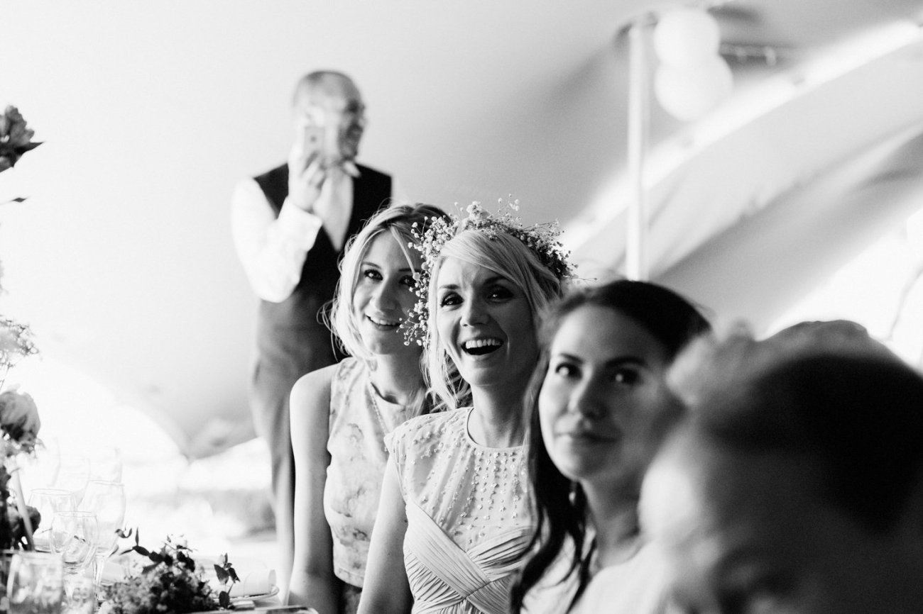 Bride and guest listen to speeches