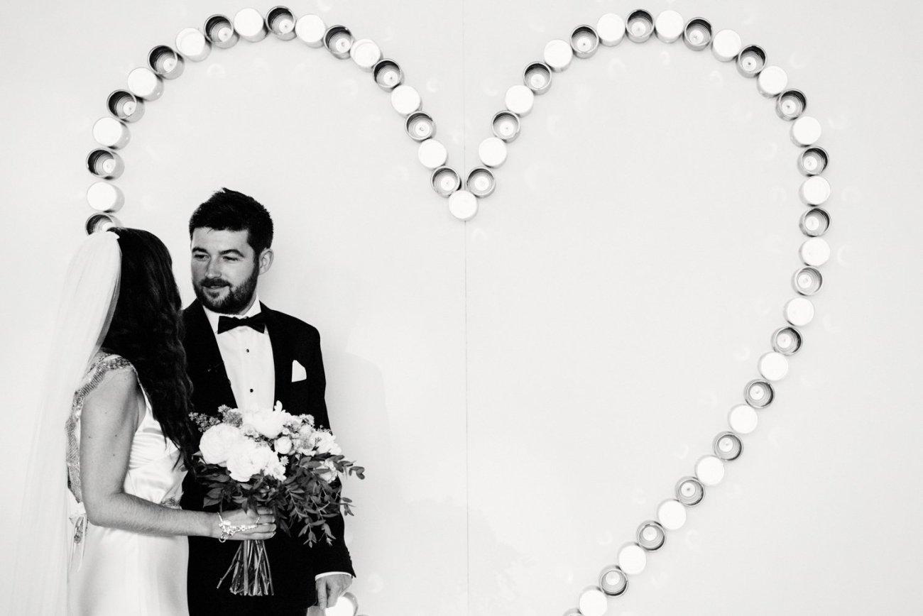 Creative wedding photography - giant heart backdrop