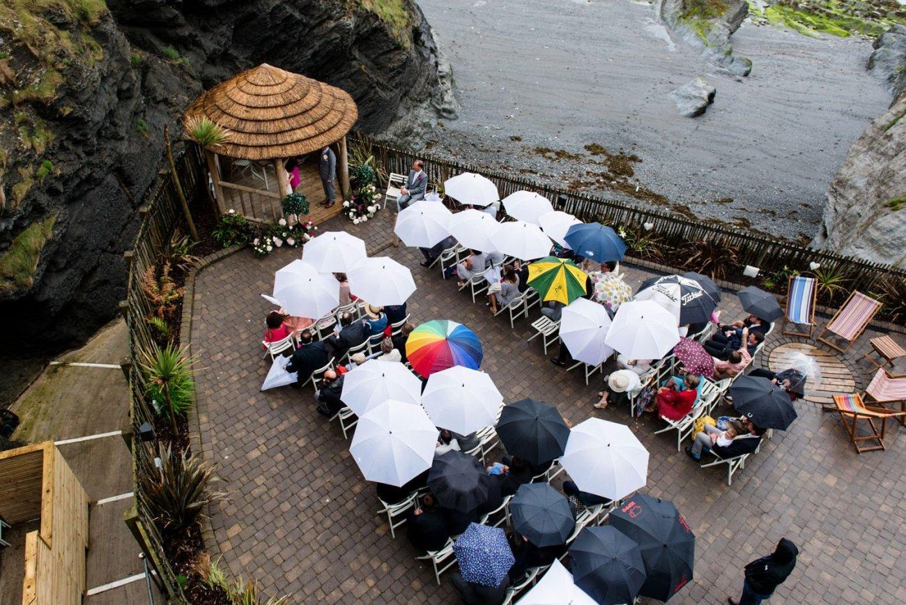 Rainy beach wedding at Tunnels Beach Devon Wedding Photography Devon