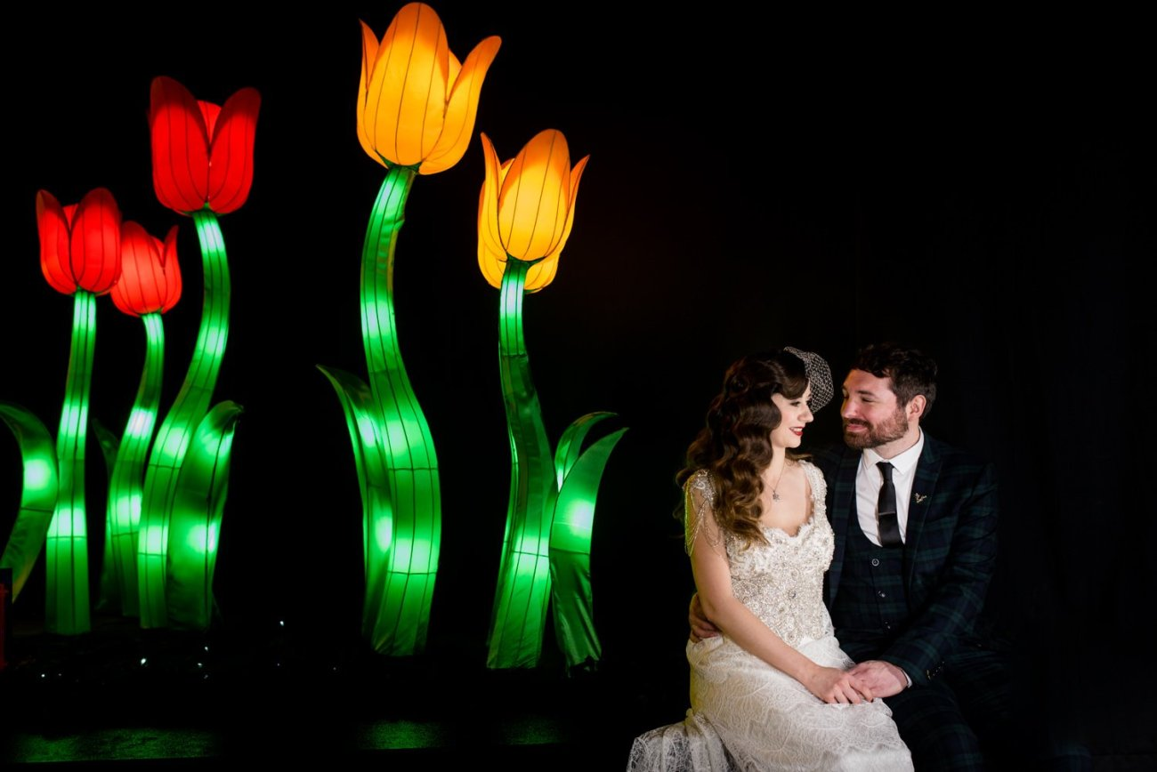 couple in front of light installation wedding photography portraits