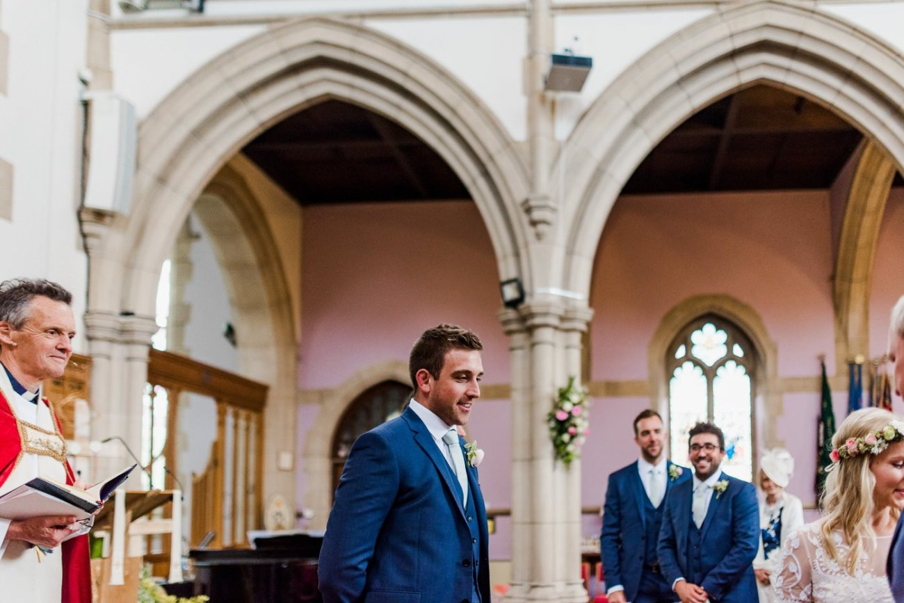 groom in blue suit paintworks wedding photographer