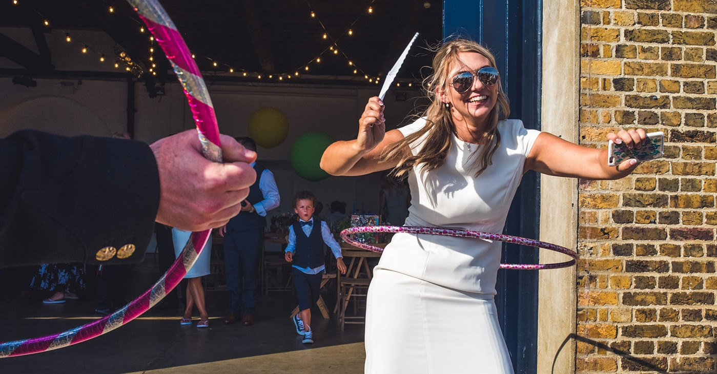 Documentary shot of bride hula hooping on wedding day