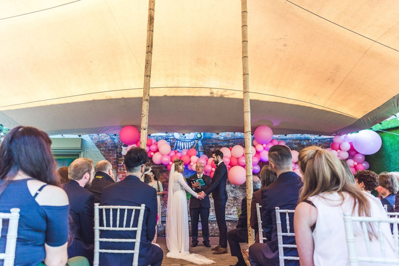 Couple get married under stretch tent canopy at Constellations Liverpool