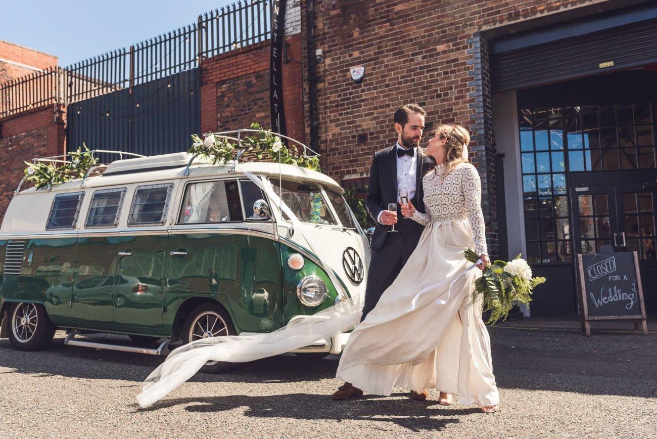 Bride and groom next to green WV camper van Constellations Liverpool