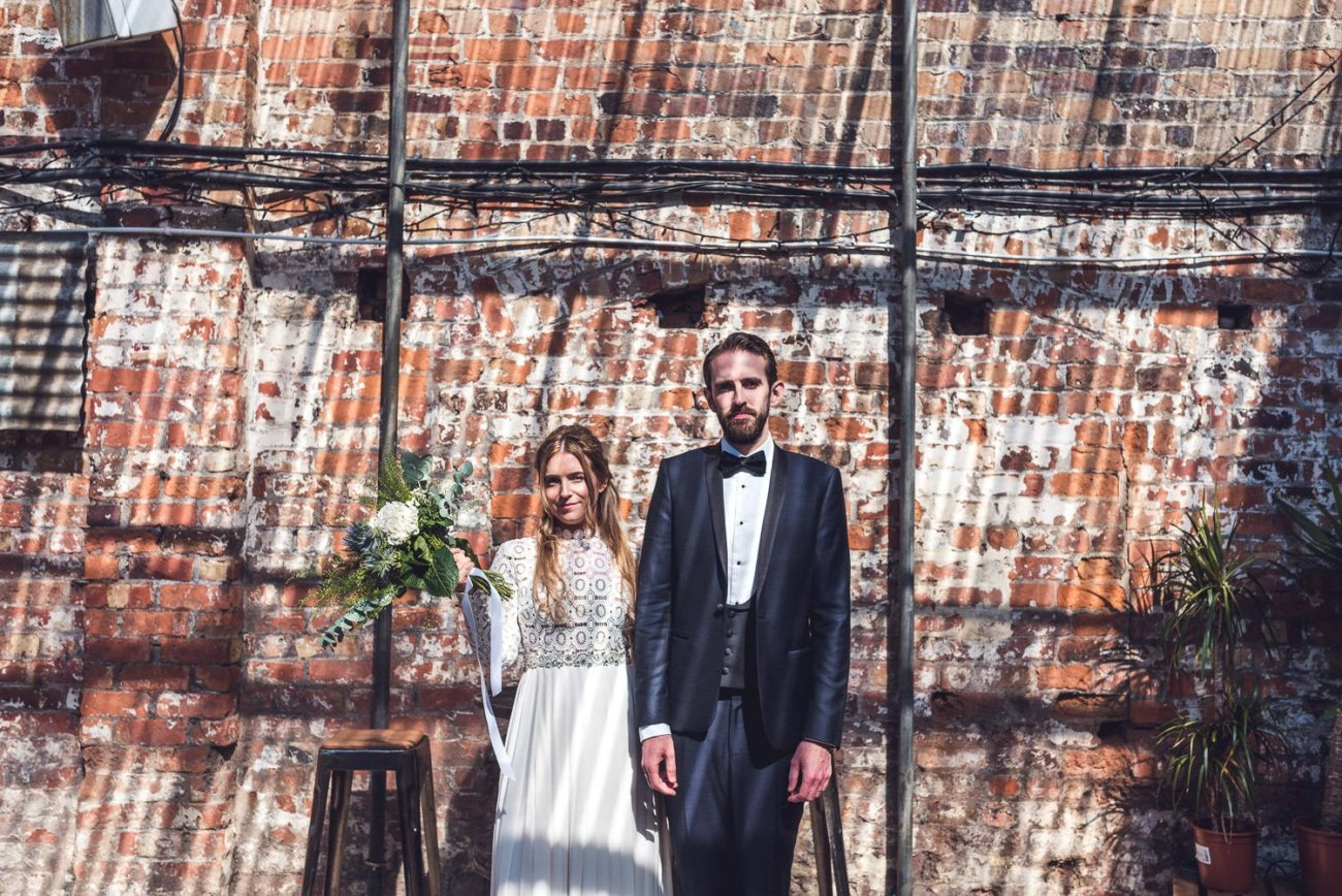 Bride and groom portrait in dappled light Constellations Liverpool wedding photography