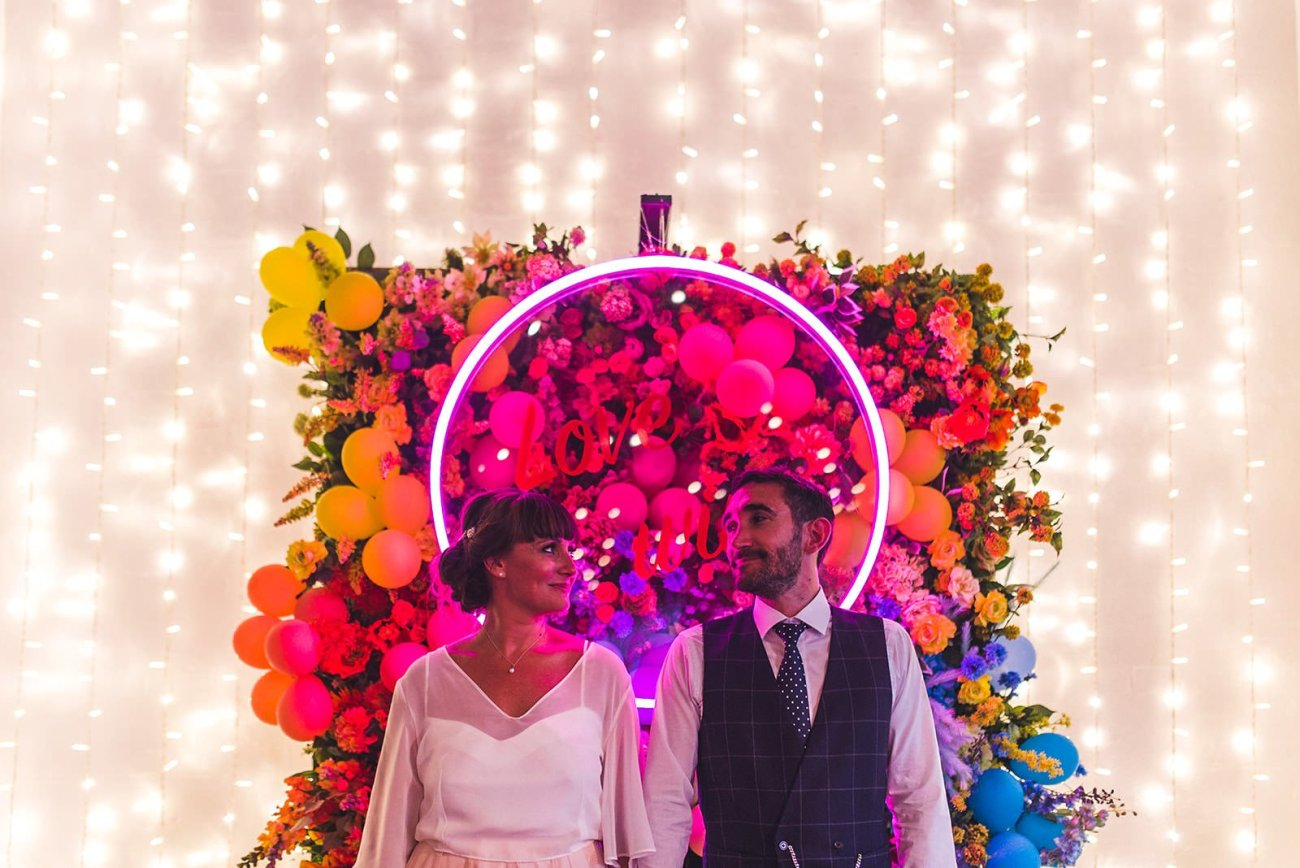 Bride and Groom in front of neon sign