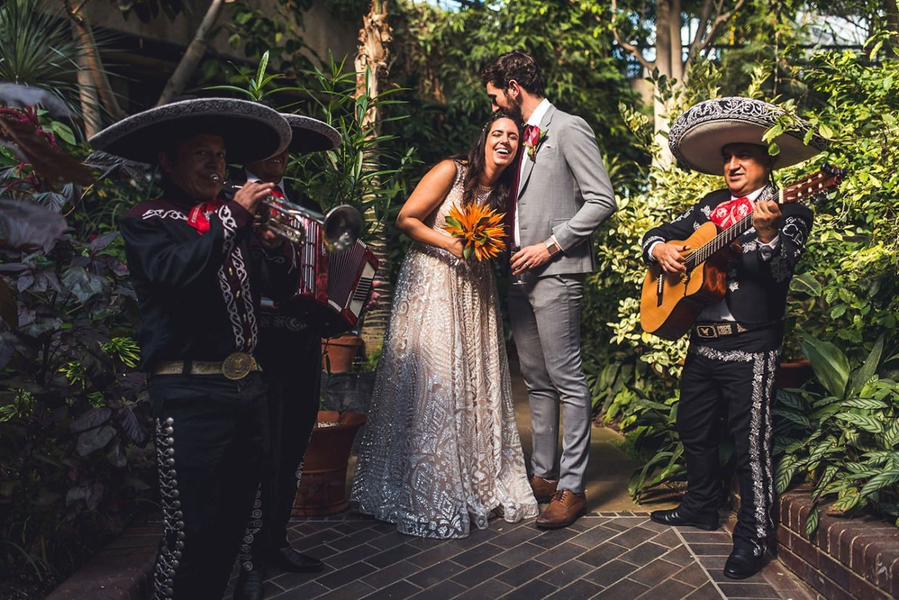 a bride and groom at the barbican conservatory