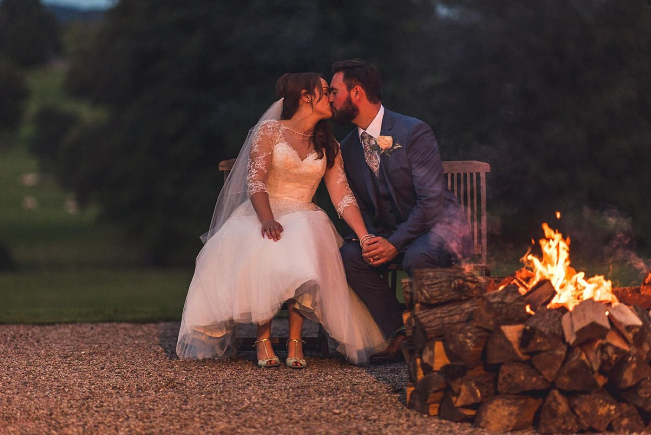 Couple by fire pit at Homme House