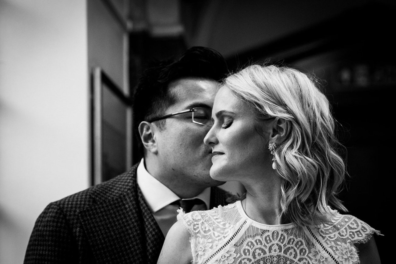 Black and white image of bride and groom at Islington Town hall