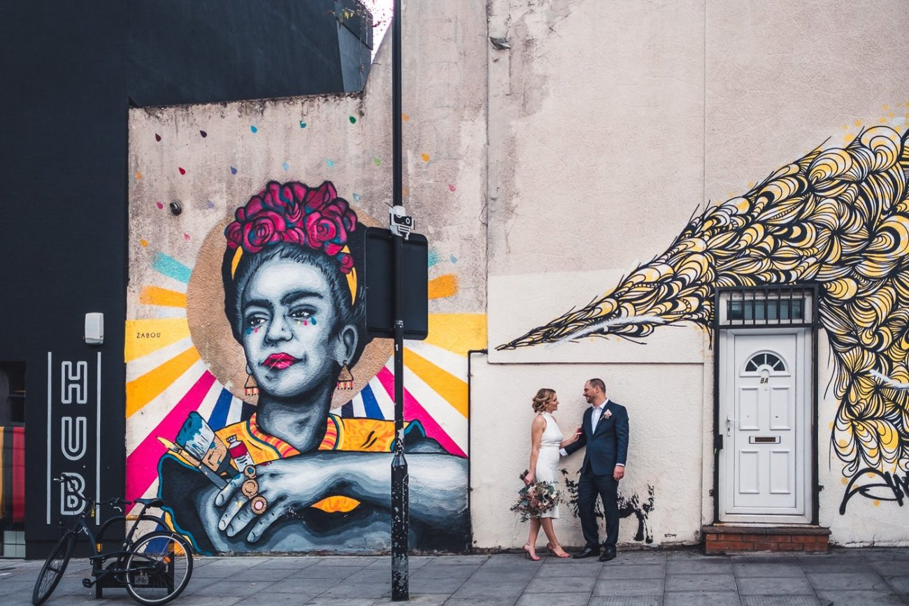 Couple in front of East London grafitti intimate socially distant wedding