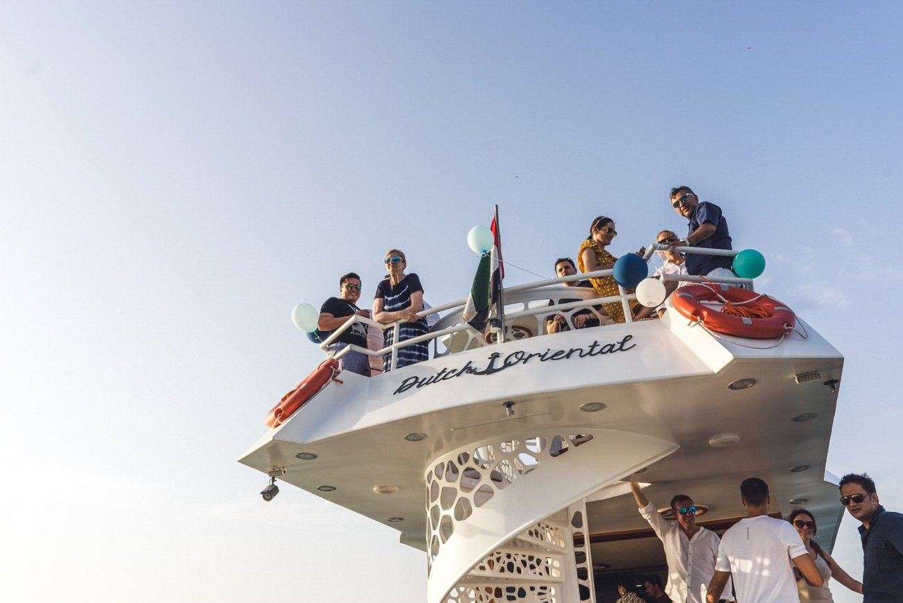 Group of people partying on yacht Dubai