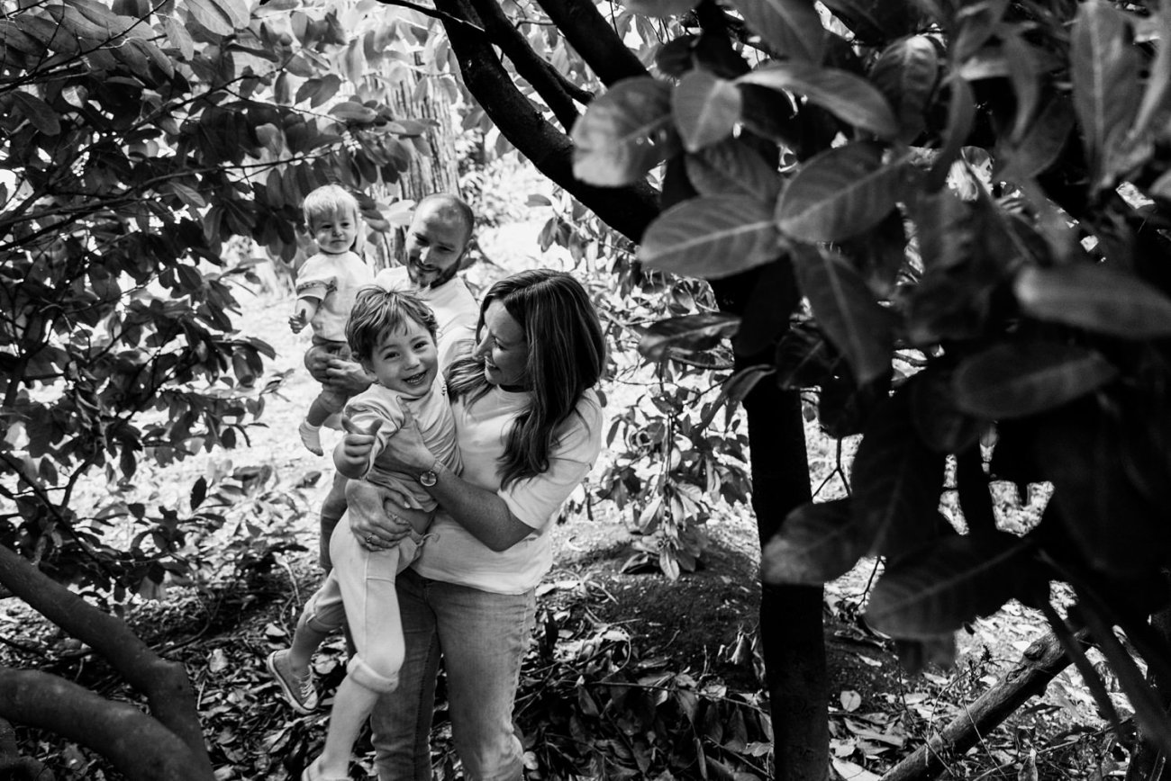 Black and white image of a family hangiing out in some trees in Cotteridge Birmingham