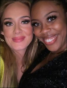 Adele parties in lime green suit