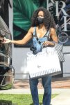 Kelly Rowland shops in denim overalls
