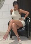 Rihanna show off skin in crochet mini dress