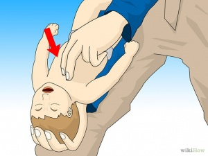 If the child is still choking, turn her face up