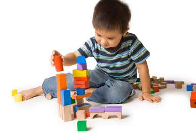 kid with wooden blocks