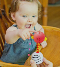 baby with musical toy