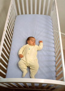 baby in a full-size crib, nursery