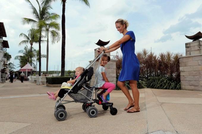 two kids in a stroller