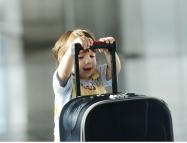 baby-pushing-suitcase-cropped