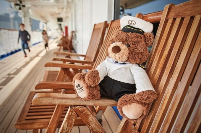 teddy bear on a deck chair on a cruise ship