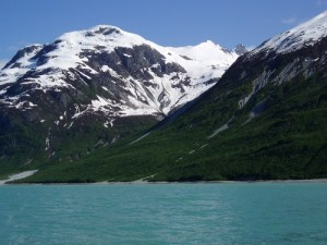 snow capped mountains and water