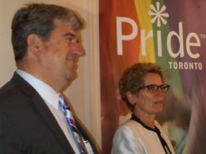 Openly gay Ontario cabinet ministers Glen Murray and Kathleen Wynne