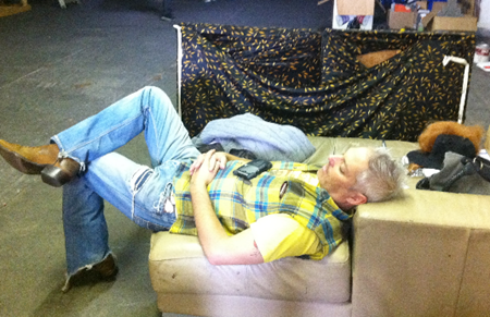 Curt (Brad King) takes a cat-ty nap on set