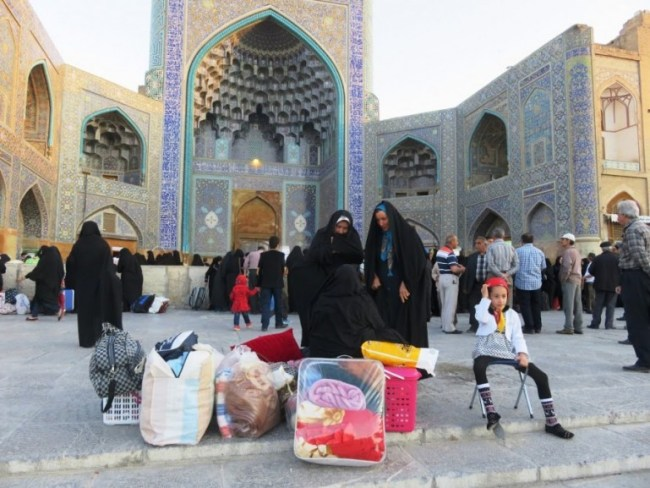 women waiting in front of the Shah mosque in Isfahan Iran