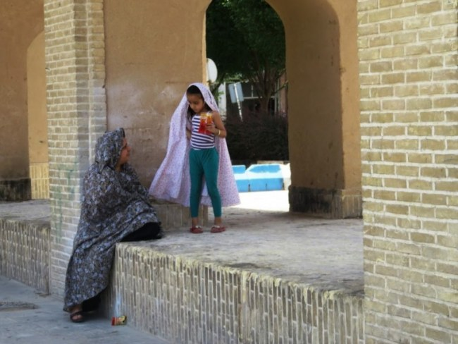 a woman and child in Yazd