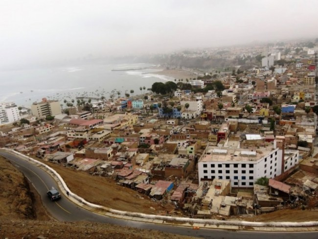 view on the ocean and the suburbs in Lima from the Peru Hop bus