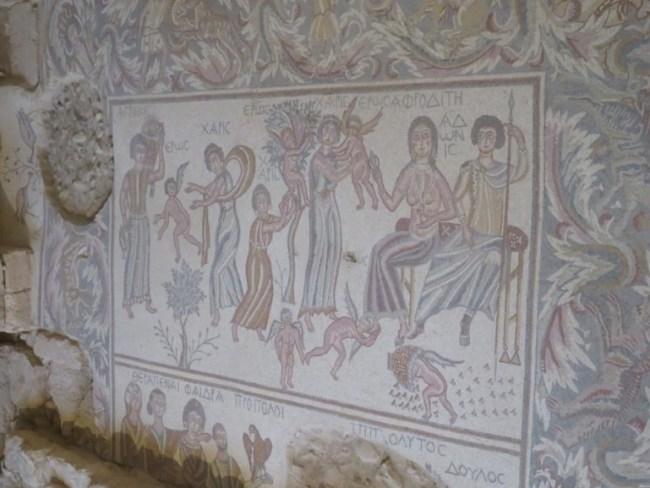 Mosaic of Afrodite spanking Eros in Madaba Jordan