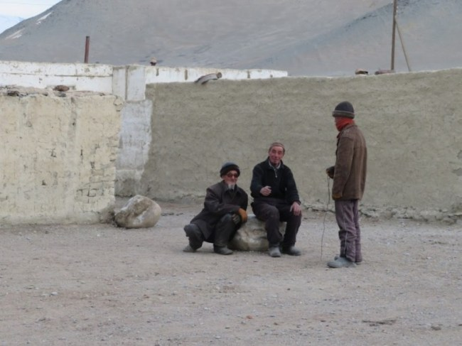 Kyrgyz men in Karakul on the Pamir highway Tajikistan