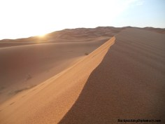 A sunset over the Moroccan desert.