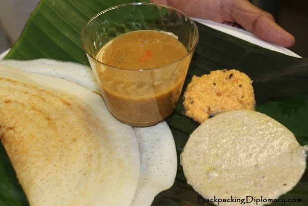 Doza, with dipping sauces on a banana leaf. Doza is a popular dish from southern India.